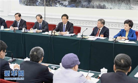 栗战书王沪宁赵乐际韩正分别参加全国人大会议一些代表团审议